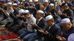 Muslims attend a mass prayer at the Dongguan Great Mosque, in Xining, Qinghai province, China. ISIS has a song in Mandarin calling on Chinese Muslims to join the jihad.  Credit: China Daily/Reuters