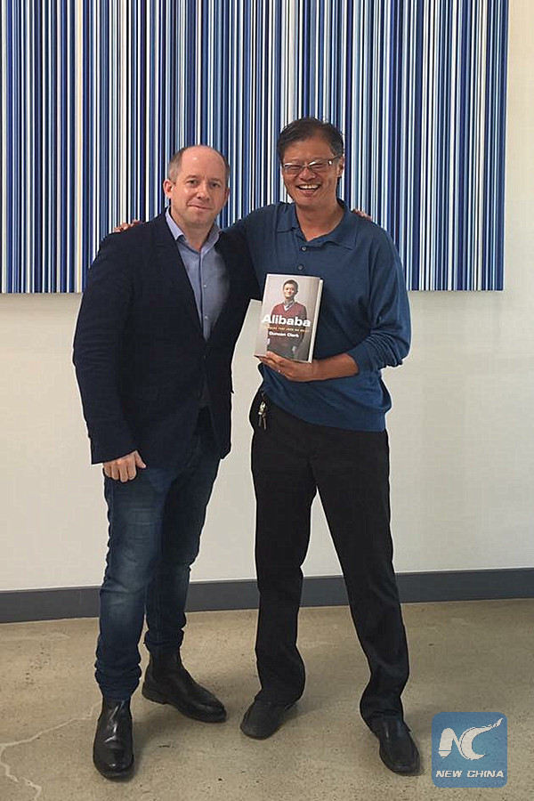Duncan Clark with Yahoo co-founder Jerry Yang holding a copy of Clark's new Alibaba book. (Credit: Duncan Clark)
