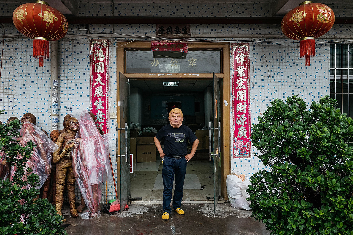 Anthony Kwan—Getty Images An employee wearing a mask of Donald Trump poses for a photograph at the Shenzhen Lanbingcai Latex Crafts Factory, October 18, 2016. The factory produces costumes and masks, including small-scale production of Donald Trump masks for local distribution within mainland China.