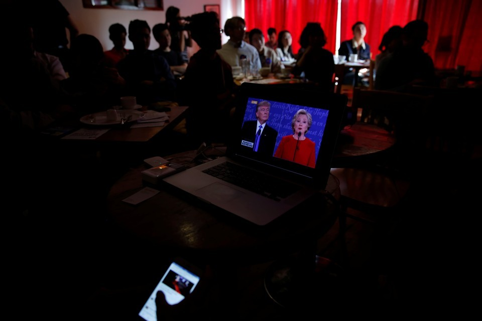 Damir Sagolj / Reuters  People watch a direct broadcast of first U.S. presidential debate in Beijing, China, September 27, 2016.